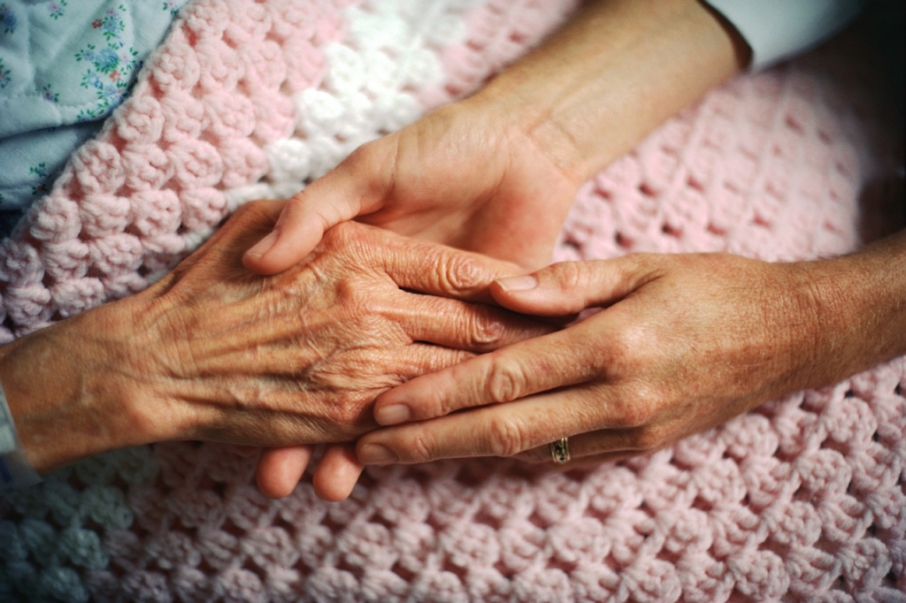 Holding Hands with Elderly Patient